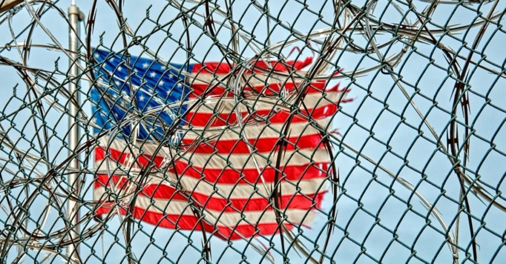 indefinite detention - american flag behind bars