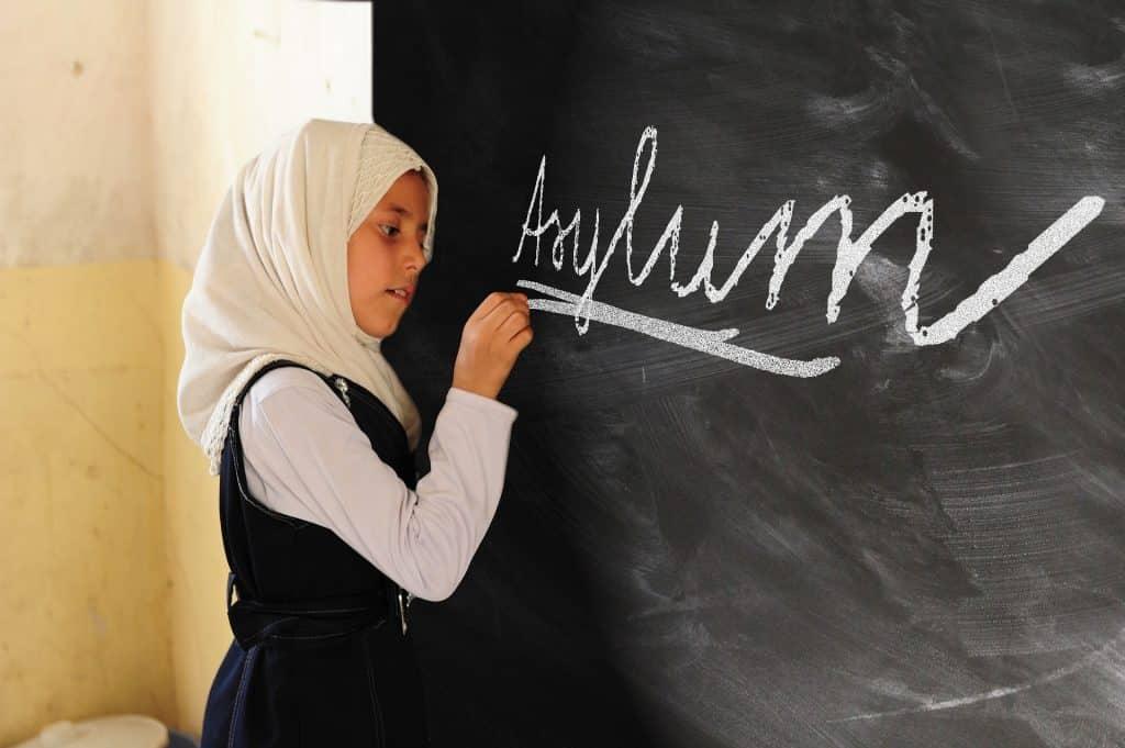 foreign girl writing asylum